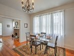 Sit down for dinner at the formal dining room table beneath a lovely chandelier.