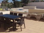 Private balcony with sunbeds and table for 8