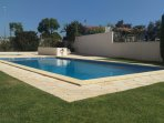 2 Pools- one for kids and another for adults with a garden
