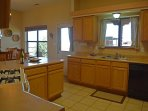 """Kitchen/dining room door out to """"Portal"""" (Spanish for covered walkway or patio)"""