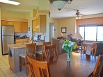 Dining table view to kitchen, living room & expansive open desert views