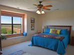 King master bedroom with ceiling fan & panoramic mesa views