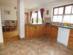 Spacious Kitchen With Easy Access To The Dining Area, Sitting Room & Garden