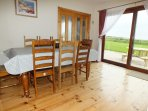 Dining Area Showing Large Patio Doors To Garden. Table & 8 Chairs