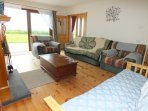 Sitting Room Large Patio Doors To Garden. Plenty of Seating Including a Sofa Bed & Open Fire
