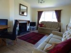 Two quality three seater settees and quality oak laminate flooring complement the lounge area