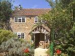 Detached natural stone built cottage with oak porch