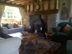 Lounge with inglenook fireplace incorporating a log burning stove