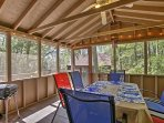 Every guest in your travel group can dine at the picnic table in the porch.