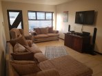 Open plan Living and Dinning room. 50' LCD TV. DSTV Explora PVR with Surround Sound System.