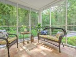 Enjoy a glass of wine in the sun room.