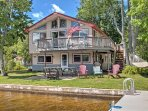 This home features a huge yard, 30-foot dock, a large deck with hammocks and so much more!