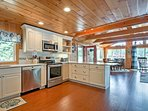 This fully equipped kitchen features stainless steel appliances and beautiful cabinetry.