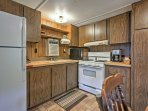 This well-equipped kitchen includes a 4-burner gas stove, oven, refrigerator, crock pot and more.