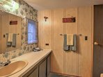 A spacious mirrored vanity provides ample primping space.