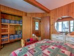 This bedroom has a queen-sized bed and a twin-over-twin bunk bed.