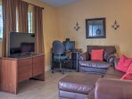 Walk into this charming home and take a seat in the living room featuring a sumptuous leather couch, leather armchair...