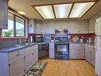 Cook up savory meals in the fully equipped kitchen with modern appliances.