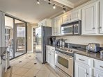 The fully equipped kitchen includes stainless steel appliances.