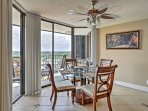 Host an elegant dinner with sunset views at the formal dining table.