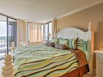 The master bedroom boasts a plush king-sized bed.