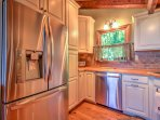 Gleaming stainless steel appliances are a main feature in this newly renovated kitchen.