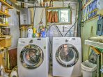 In-unit laundry machines are among the numerous comforts of home at this property.