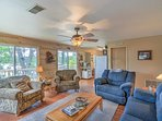 Plush furnishings and ample amenities welcome you to a lakeside retreat.
