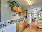 The kitchen includes a stove, oven, refrigerator, microwave and coffeemaker.