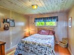 Sink into the second bedroom's cozy queen-sized bed.
