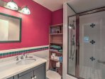 The full bathroom offers a spacious walk-in shower.