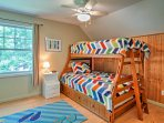 Perfect for those traveling with kids, this room has a twin-over-full bunk bed and space to play.