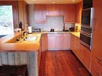 Galley kitchen with amazing appliances.