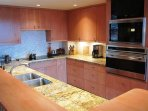 Galley kitchen with lots of counterspace.