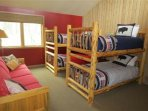 Upstairs bunk room with log accents.