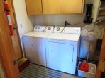 The laundry room with a full size washer and dryer.