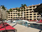 Plenty of chairs all around our spacious pool.