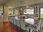 The spacious kitchen offers ample seating at the island.