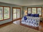 Rest easy in the master bedroom's king bed.