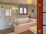 The master bathroom has a walk-in shower and a bath tub for your convenience.