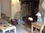 Wood burning stove in an inglenook fire place.