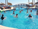Start your pool day with water aerobics, fun and social.