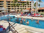Kick it up a notch with a lively game of pool volleyball.