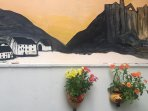 Mural in court yard to reflect the views from the front