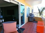 Your private balcony with outdoor furniture and large BBQ-grill.