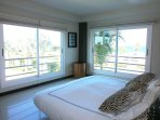 The Majestic Master bedroom with great ocean view and poolside view.