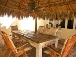 Large palapa with 6-seat dining table.