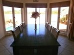 6-seat dining table overlooking the patio and swimming pool.