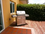 Private patio with outdoor furniture a hot tub and BBQ grill