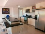 Full-size fully equipped kitchen with 4-seat bar-table